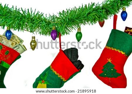 stockings filled with coal and money - stock photo