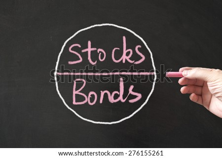 Stocks and bonds conceptional diagram drawn on blackboard using chalk - stock photo