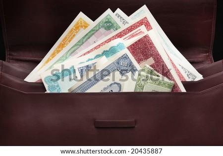 Stocks in portfolio case - stock photo