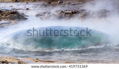 Stokkur geyser eruption in a beautiful sunny day in Iceland.