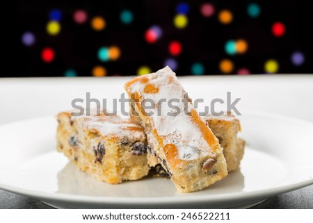Stollen Cake Pieces on a White Plate   - stock photo