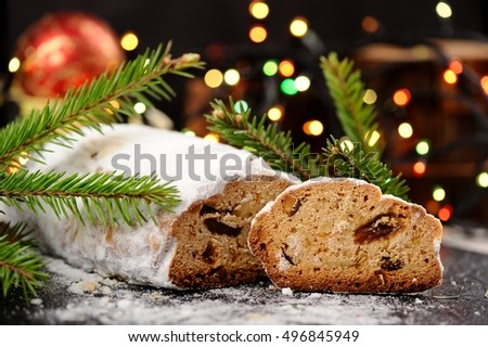 Stollen in icing sugar with colored bokeh closeup