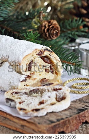 Stollen.Traditional German Christmas cake on a rustic festive table. - stock photo