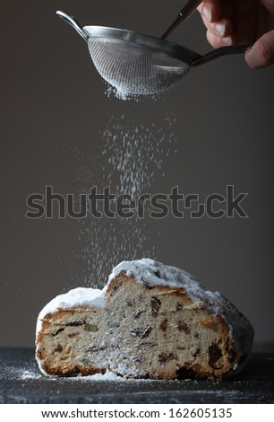 stollen with icing sugar  - stock photo