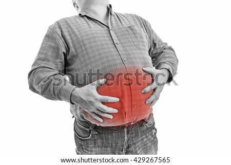 Stomach ache, man placing hand on the spot. People, health care and problem concept - unhappy man suffering. - stock photo