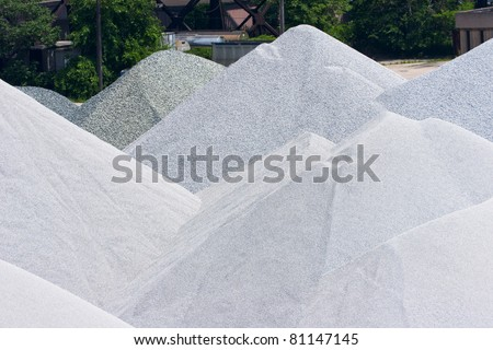 Stone Aggregate Mounds Huge mounds of assorted stone aggregate used in the concrete making process just freshly offloaded from an ore boat - stock photo