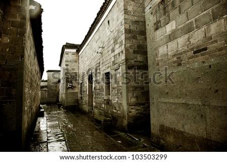stone alley under rain - stock photo