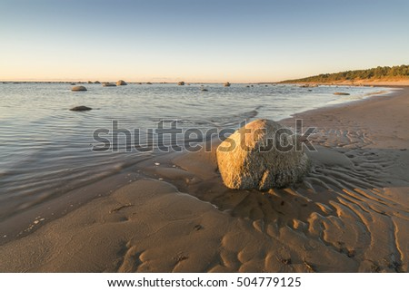 stone and formations of sand in sunset light