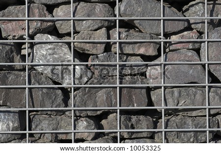 Stone and steel grille wall - stock photo