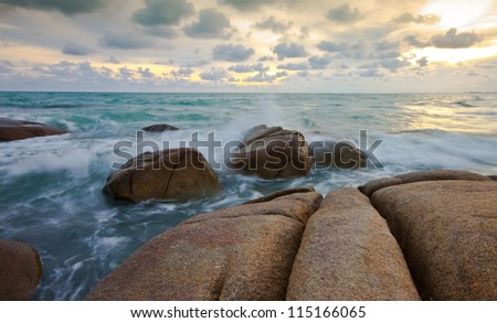 stone and waves during sundown. Natural composition