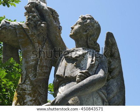 Stone angel and cross