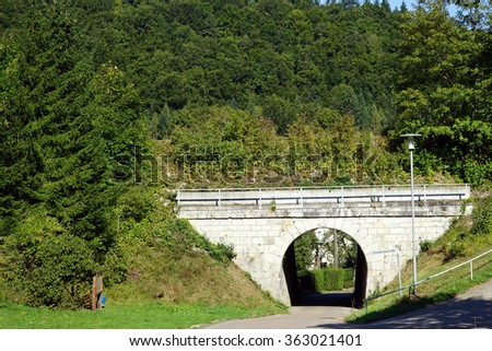 Stone arch bridge and forest on the hill in Swabia, Germany