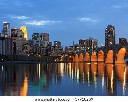 Stone Arch bridge and Mississippi river in downtown Minneapolis - stock photo