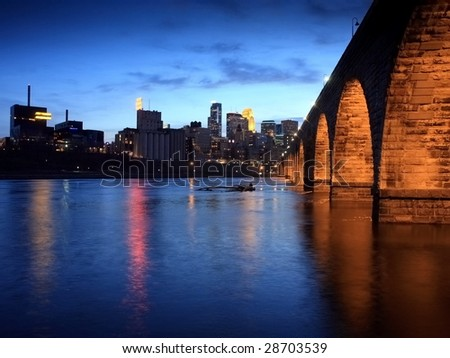 Stone Arch bridge over Mississippi in downtown Minneapolis - stock photo