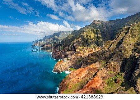 Stone arch on the beach by Honopu Valley, Na Pali State Park, Kauai, Hawaii - stock photo
