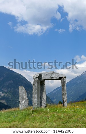 Stone arch with mountains in the background - stock photo