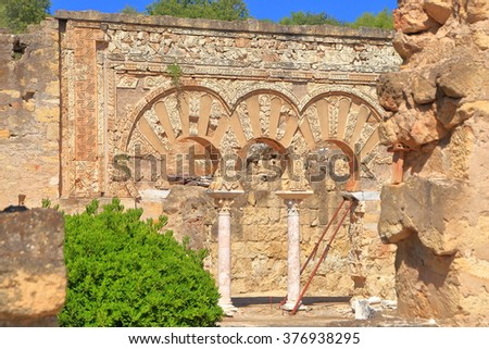Stone arches with Moorish design at the House of Jafar in Medina Azahara, Cordoba, Andalusia, Spain