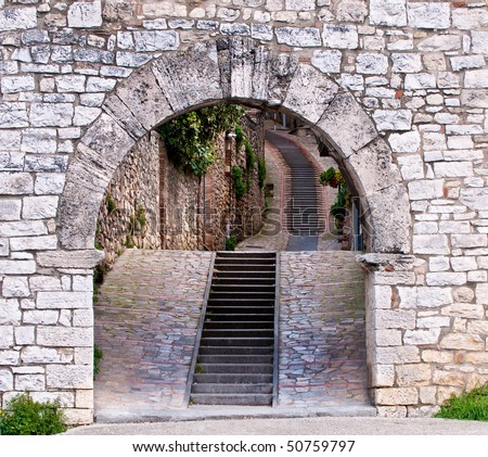 Stone archway and stairs leading into medieval town