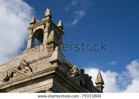Stone artwork on old english mausoleum roof - stock photo