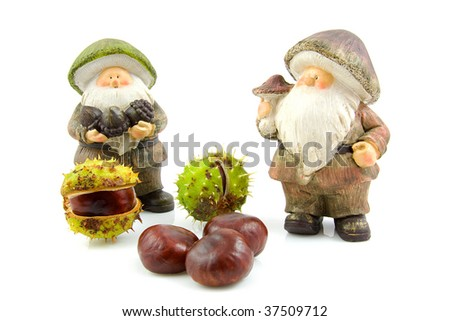 stone autumn statue doll of gnome with chestnuts  isolated on white background - stock photo