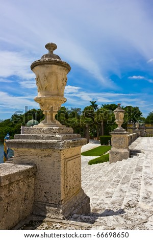 stone balustrade with decorative vases, Vizcaya Museum & Garden in Miami, Florida - stock photo