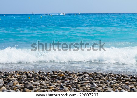 stone beach and turquiose water of cote dAzur, France
