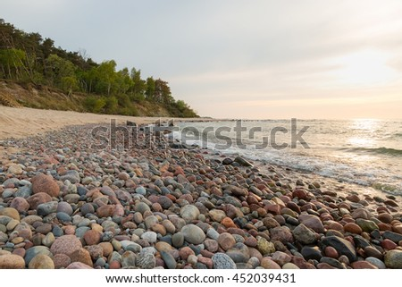 Stone beach at the small lagoon of the sea - stock photo