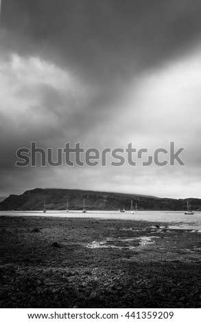 Stone Beach Seascape Fjord Bay With Sailboats And Stormy Clouds In Background - stock photo