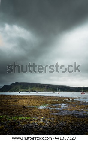 Stone Beach Seascape Fjord Bay With Sailboats And Stormy Clouds In Background