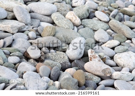 Stone beach. Small stones at the seaside. - stock photo