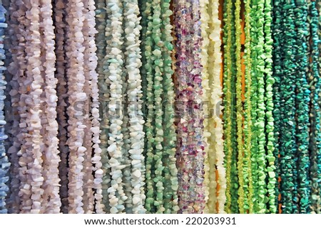 Stone bead necklaces of different colors - stock photo