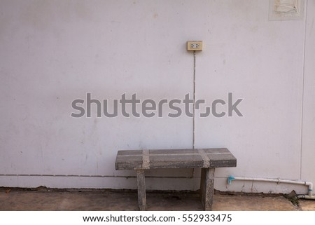 stone bench and plug on the wall