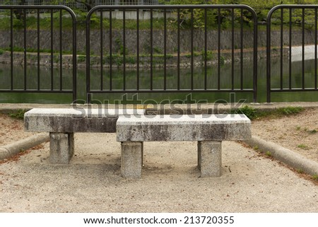 Stone bench near river, Kyoto, Japan. - stock photo