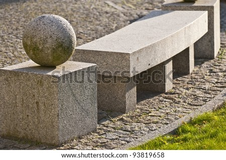 Stone bench with stone balls - stock photo