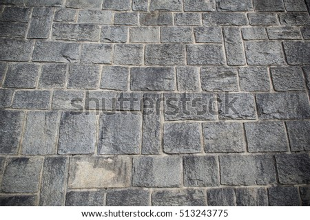 stone block wall with different sized blocks
