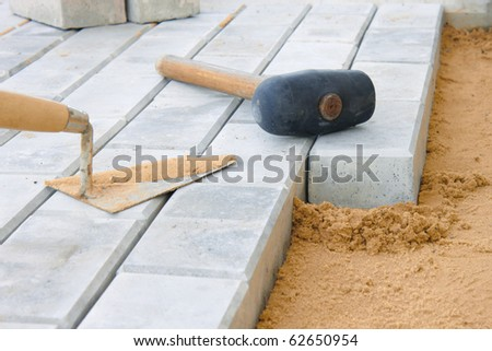 Stone blocks laying down on sand - stock photo