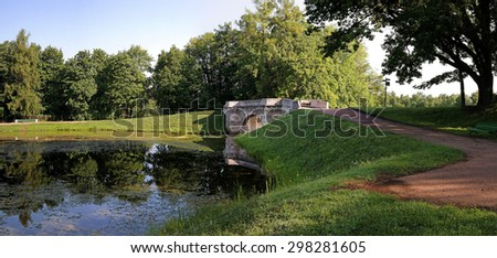 stone bridge in a park in Gatchina on the shores of Silver Lake