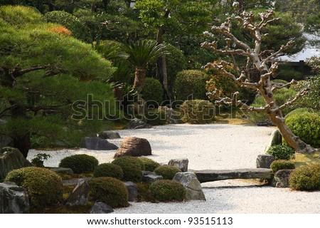 Stone bridge in a zen garden in Kyoto (Japan) - stock photo