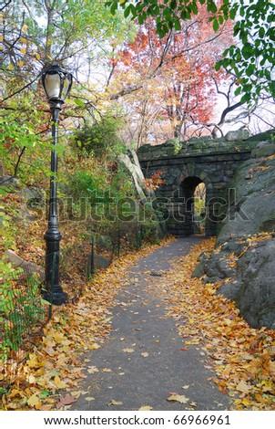 Stone bridge in Autumn in New York City Central park. - stock photo
