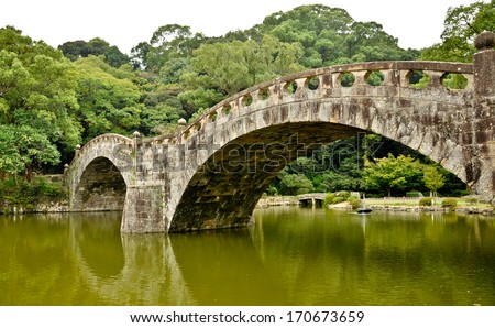 Stone bridge in Japanese garden at Isahaya, Japan