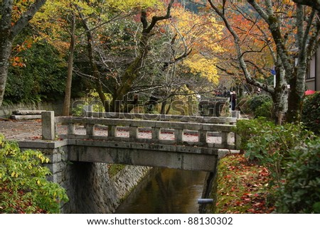 Stone bridge in philosopher's path in Kyoto (Japan) - stock photo