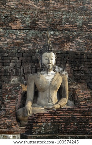 Stone Buddha with brick background, Thailand
