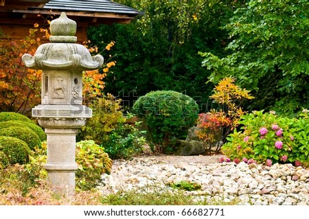 Stone buddhist lamp in japanese garden