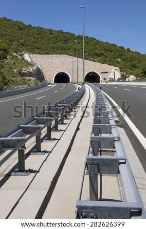 Stone build portal of tunnel on highway in Croatia  - stock photo