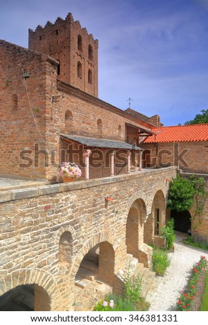Stone buildings of the church and cloister of St Martin du Canigou monastery, Pyrenees-Orientales department, France
