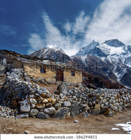 Stone cabin in the mountain, along the trail to Mount Everest Base Camp, Nepal Himalaya  - stock photo