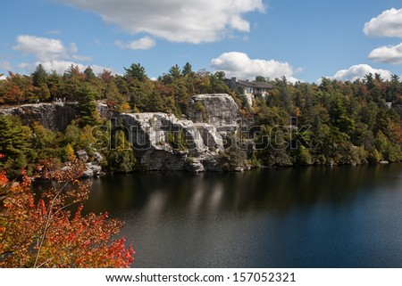 Stone cabin on the cliffs above the lake at Minnewaska State Park. - stock photo