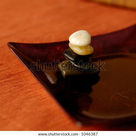 Stone Cairn in Asian plate - stock photo