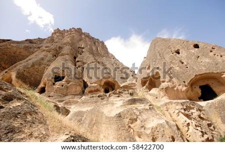Stone carved castle in Cappadocia, Turkey - stock photo