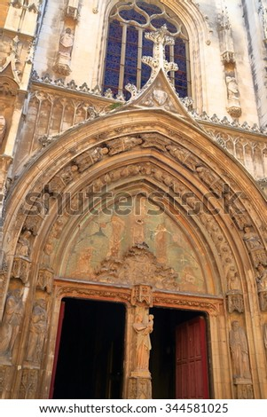 Stone carved decorations above the door to Gothic church in Aix-en-Provence, France - stock photo
